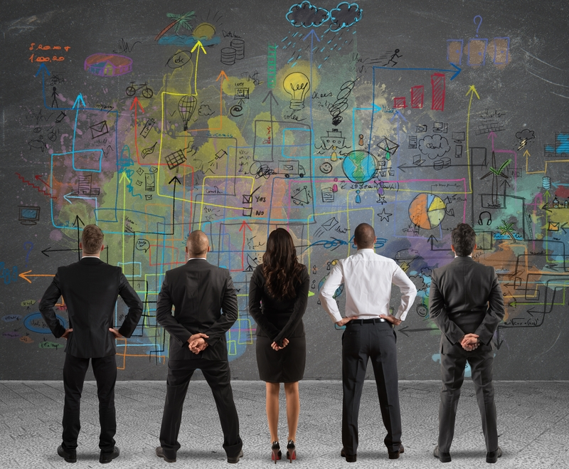 Business team drawing a new project | © Alphaspirit | Dreamstime Stock Photos